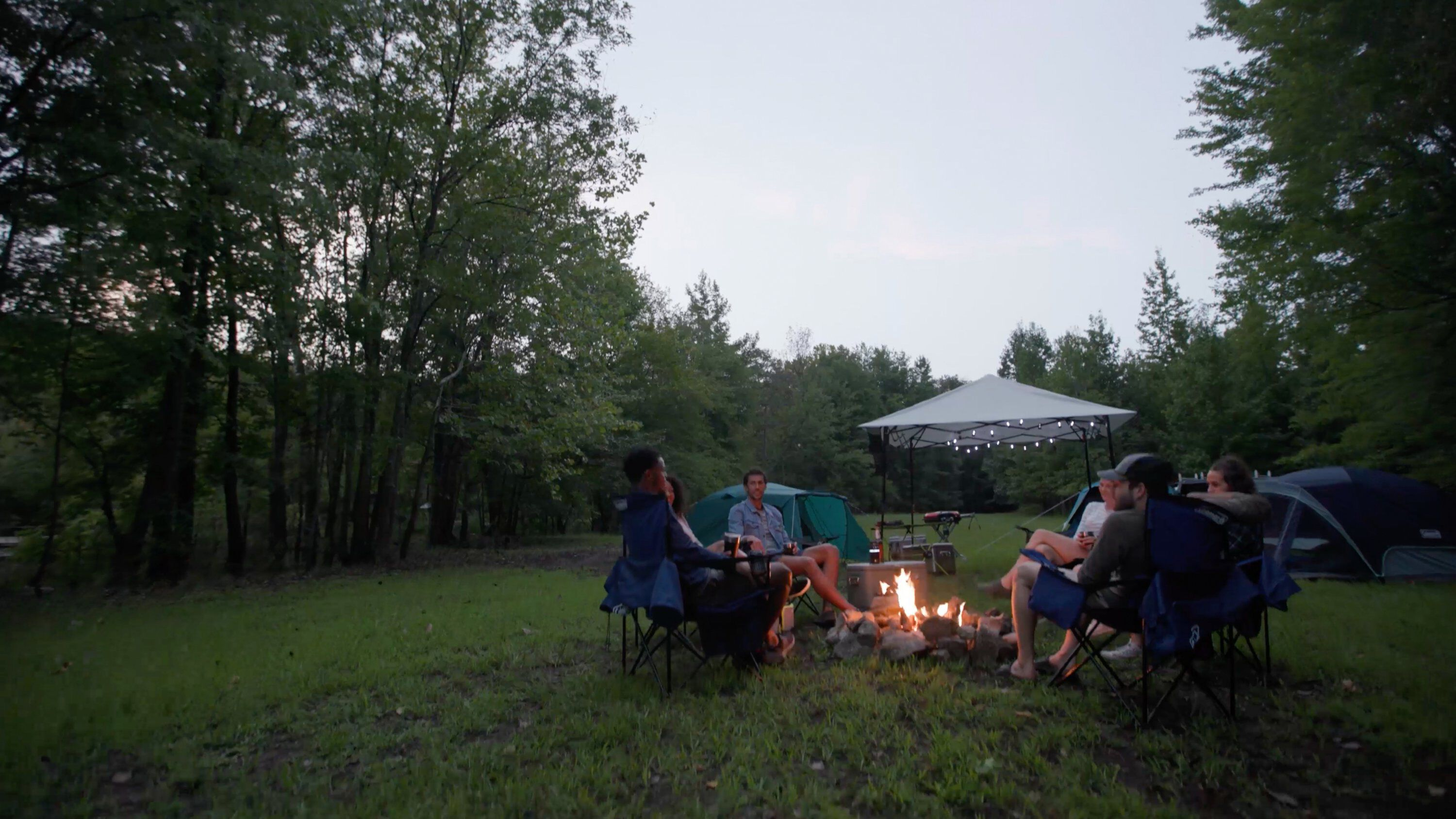 Outdoor folding chairs around fire