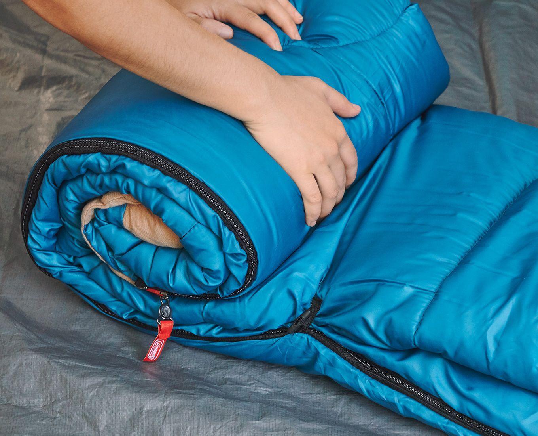 sleeping bag being setup inside tent